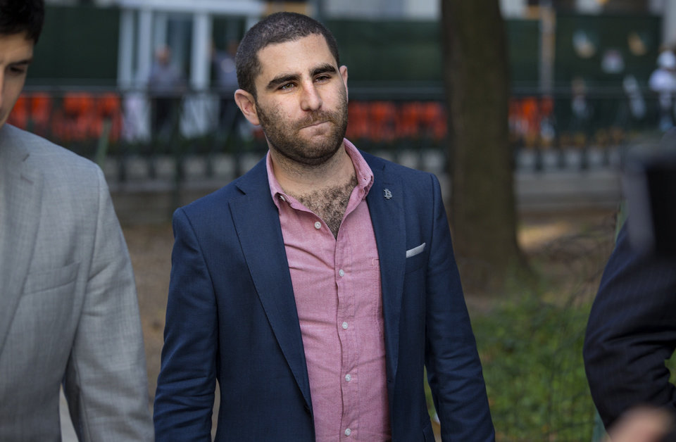 Photo - Charles Shrem, the top executive of a New York City-based Bitcoin company, walks from the federal court house in New York Thursday, Sept. 4, 2014, after pleading guilty to federal charges that he helped smooth the way for drug transactions on the online marketplace Silk Road. (AP Photo/Craig Ruttle)