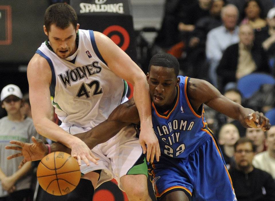 Photo - Minnesota Timberwolves' Kevin Love (42) and Oklahoma City Thunder's Jeff Green (22) chase after a loose ball during the third quarter of an NBA basketball game in Minneapolis on Sunday, Feb. 21, 2010. The Thunder won 109-107. (AP Photo/Hannah Foslien) ORG XMIT: MNHF107