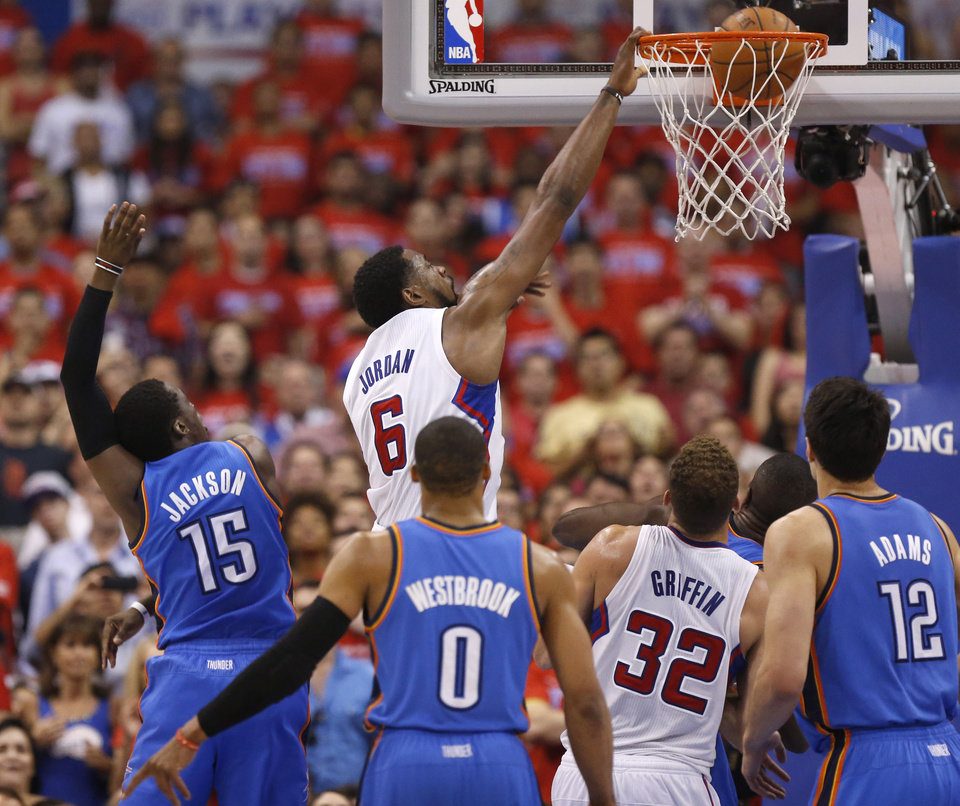 Photo - Los Angeles' DeAndre Jordan (6) dunks beside Oklahoma City's Reggie Jackson (15) during Game 6 of the Western Conference semifinals in the NBA playoffs between the Oklahoma City Thunder and the Los Angeles Clippers at the Staples Center in Los Angeles, Thursday, May 15, 2014. Photo by Nate Billings, The Oklahoman