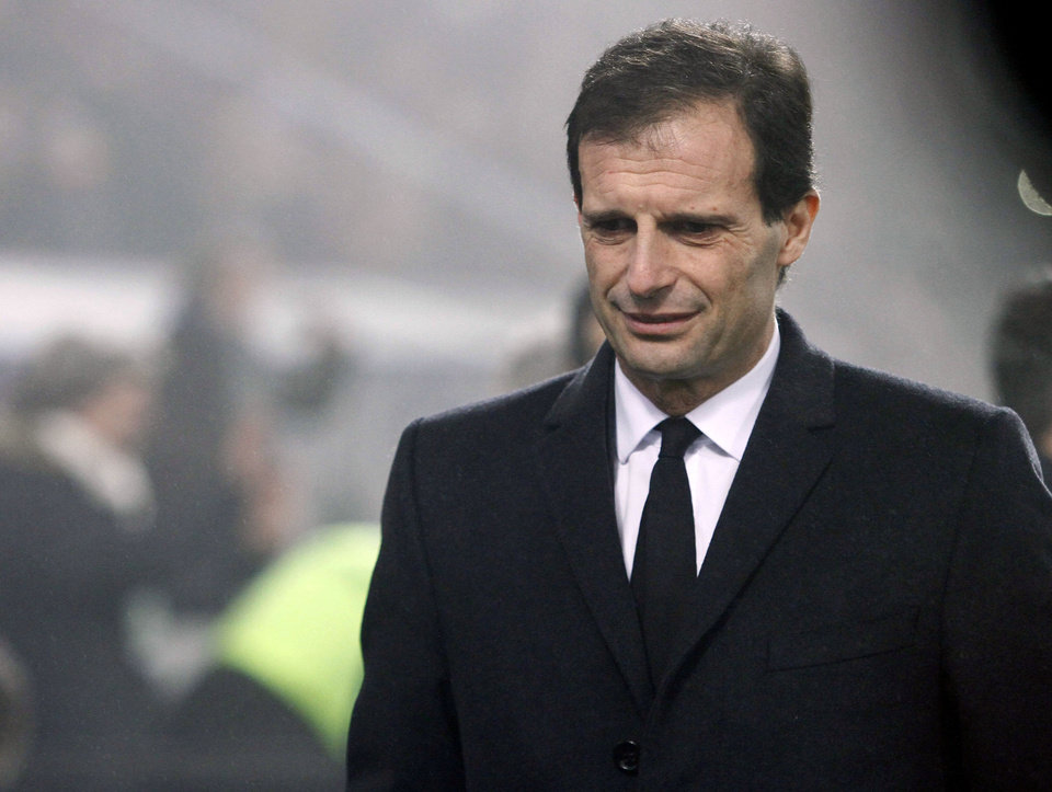 Photo - AC Milan's coach Massimiliano Allegri looks down, during a Serie A soccer match against Sassuolo, at Reggio Emilia's Mapei stadium, Italy, Sunday, Jan. 12, 2014. (AP Photo/Davide Spada, Lapresse)