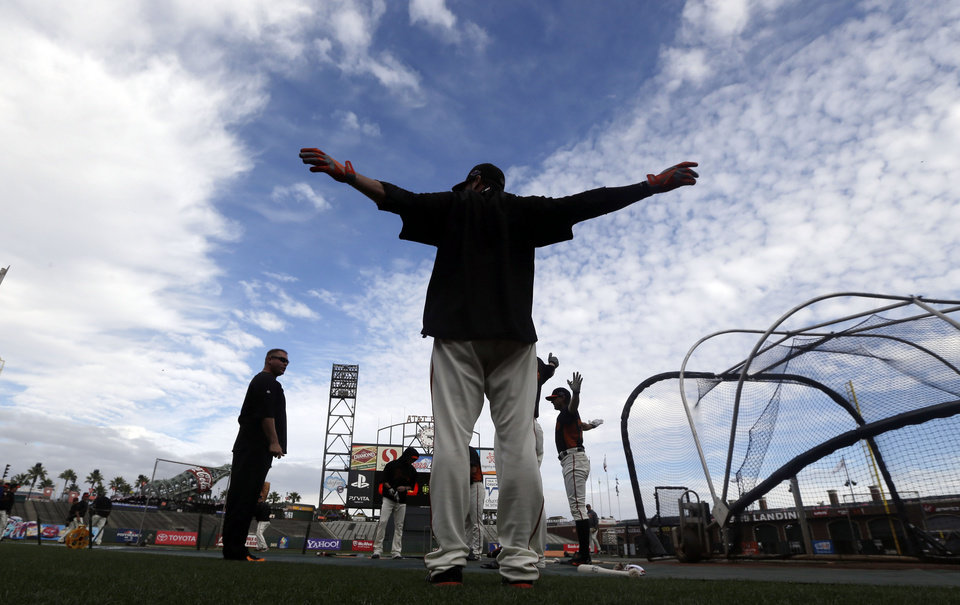 San Francisco Giants pitcher Ryan Vogelsong, center, stretches with fellow pitchers during baseball practice, Friday, Oct. 5, 2012 in San Francisco. The Giants host the Cincinnati Reds in Game 1 of the National League division series on Saturday. (AP Photo/Marcio Jose Sanchez)