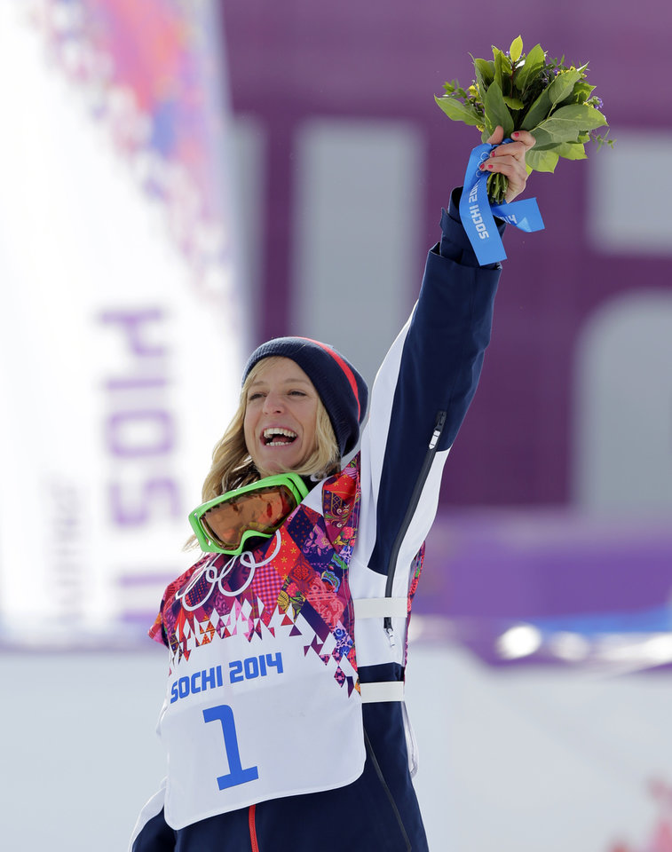 Photo - Britain's Jenny Jones celebrates after winning the bronze medal in the the women's snowboard slopestyle final at the 2014 Winter Olympics, Sunday, Feb. 9, 2014, in Krasnaya Polyana, Russia.  (AP Photo/Andy Wong)