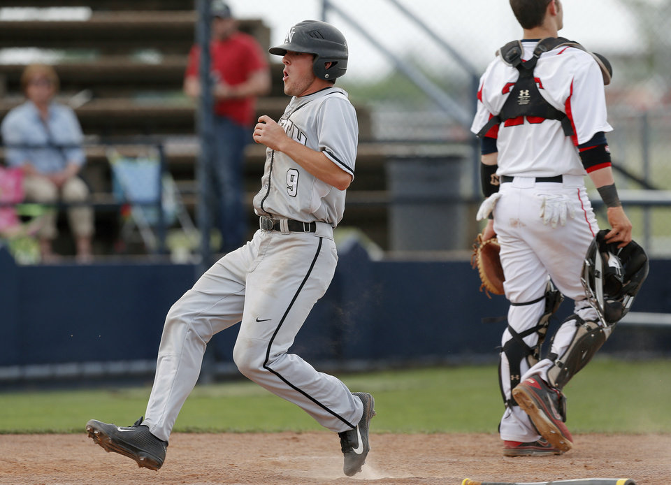 Photo - Norman North's Dylan Sterling scores the game-winning run in the seventh inning against Yukon during a Class 6A state baseball tournament game in Shawnee, Okla., Friday, May 10, 2013. Photo by Bryan Terry, The Oklahoman