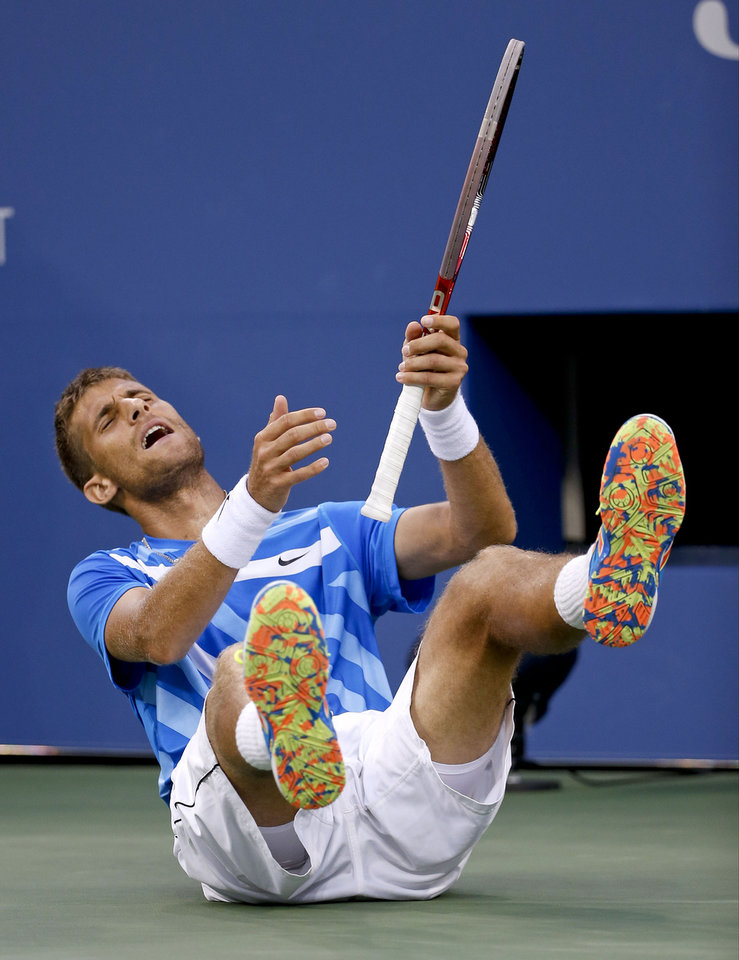 Photo - Martin Klizan of Slovakia reacts after a point to Tomas Berdych, of the Czech Republic, during the second round of the 2014 U.S. Open tennis tournament, Friday, Aug. 29, 2014, in New York. (AP Photo/Jason DeCrow)