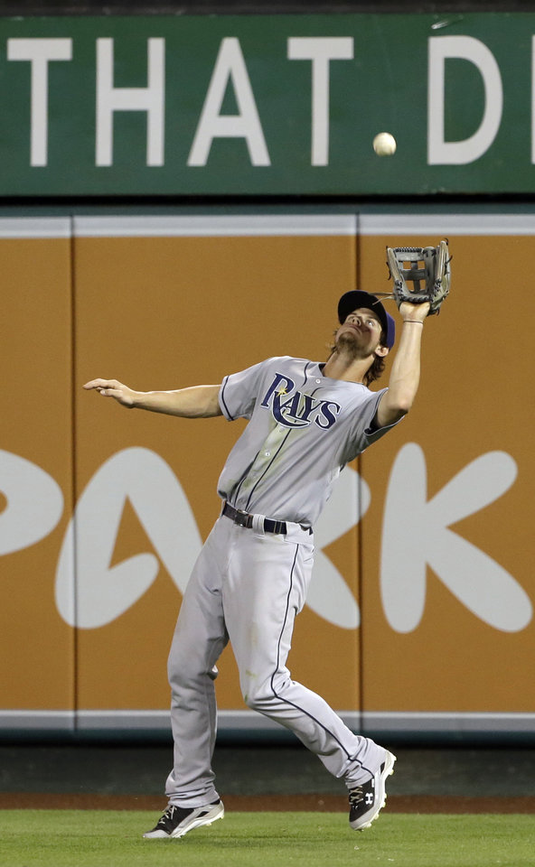 Photo - Tampa Bay Rays right fielder Will Myers catches a fly off Mike Trout of the Los Angeles Angels in the fourth inning of a baseball game in Anaheim, Calif., Monday, Sept. 2, 2013. (AP Photo/Reed Saxon)