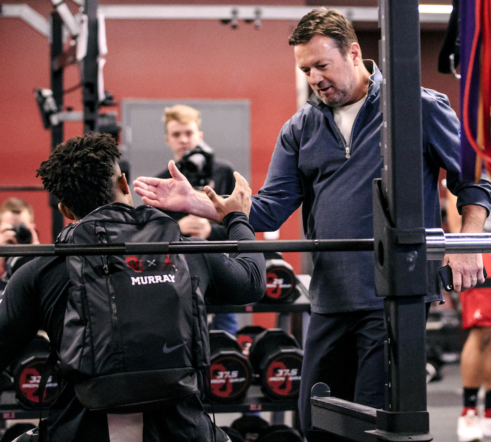 Photo - Former University of Oklahoma coach Bob Stoops shakes hands with Kyler Murray before Murray worked out for NFL scouts during the University of Oklahoma football pro day at the University of Oklahoma in Norman, Okla. on Wednesday, March 13, 2019.   Photo by Chris Landsberger, The Oklahoman