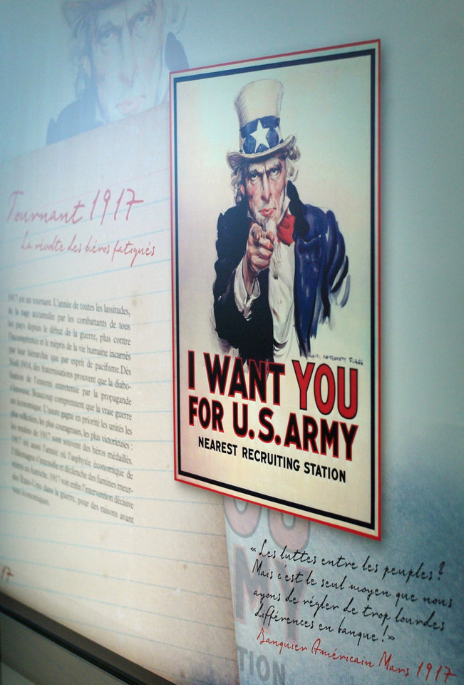 Photo - In this April 8, 2014 photo, a reproduction of James Montgomery Flagg's Uncle Sam recruitment poster from 1917 is displayed as part of the exhibition
