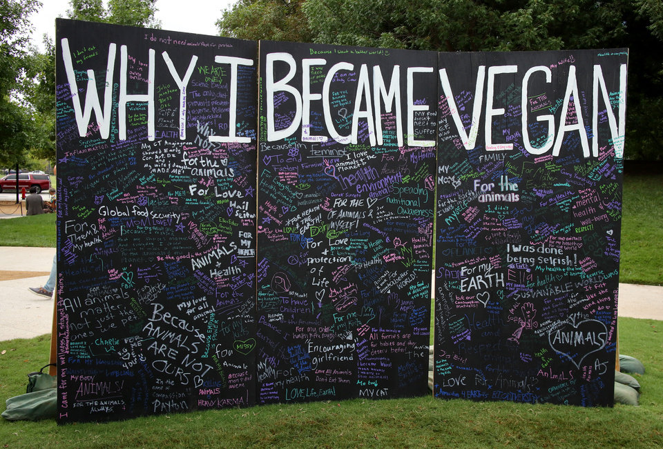 "Photo - Big board to sign, ""Why I Became a Vegan"" at the inaugural Veg Fest on the Great Lawn at the Myriad Botanical Gardens, Saturday, September 8, 2018.  Photo by Doug Hoke, The Oklahoman"
