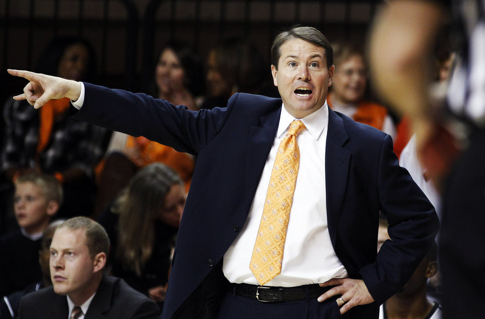 Photo -   Oklahoma State head coach Travis Ford gestures to an official during the second half of an NCAA college basketball game against Oklahoma State in Stillwater, Okla., Sunday, Nov. 25, 2012. Oklahoma State won 81-58. (AP Photo/Sue Ogrocki)