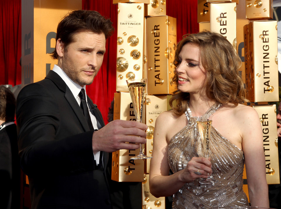 Peter Facinelli, left, and Vitalie Taittinger give the Champagne Taittinger Red Carpet Opening Toast at the 19th Annual Screen Actors Guild Awards at the Shrine Auditorium in Los Angeles on Sunday Jan. 27, 2013. (Photo by Matt Sayles/Invision/AP)