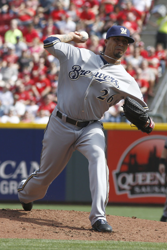 Photo - Milwaukee Brewers starting pitcher Kyle Lohse throws against the Cincinnati Reds during the first inning of a baseball game, Sunday, May 4, 2014, in Cincinnati. (AP Photo/David Kohl)
