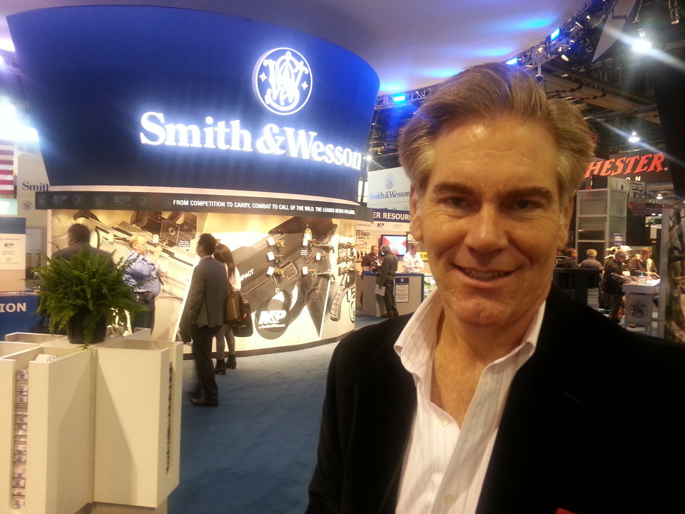 Photo -  Steve Scott of Norman poses at the Smith & Wesson booth at the 2015 SHOT Show in Las Vegas, Nev.
