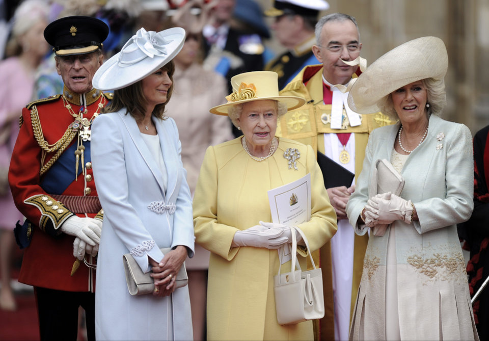 Photo - From left, Prince Phillip, Carole Middleton, Britain's Queen Elizabeth II and Camilla, Duchess of Cornwall stand outside of Westminster Abbey after the Royal Wedding in London Friday, April, 29, 2011. (AP Photo/Martin Meissner) ORG XMIT: RWMG164