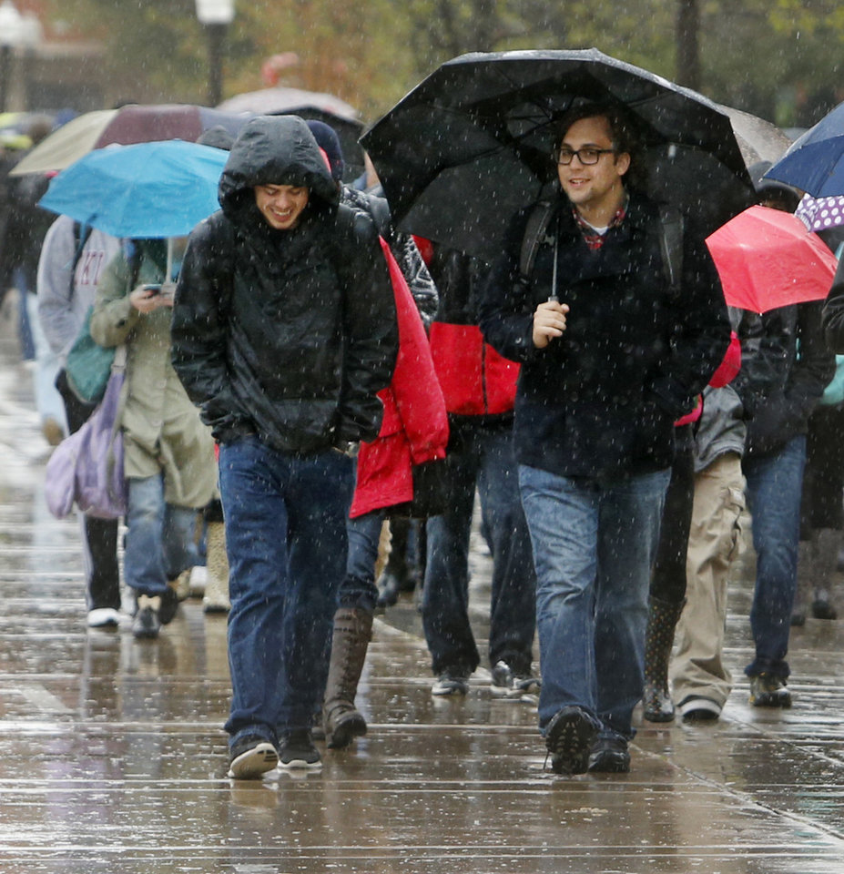 Photo - Students walk to class in the rain at the University of Oklahoma on Wednesday, April 10, 2013, in Norman, Okla.  Photo by Steve Sisney, The Oklahoman
