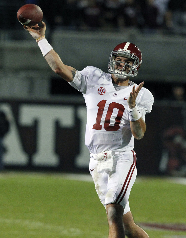 Photo - Alabama quarterback AJ McCarron (10) throws a pass during the first half of an NCAA college football game against Mississippi State, Saturday, Nov. 16, 2013, in Starkville, Miss. (AP Photo/Butch Dill)