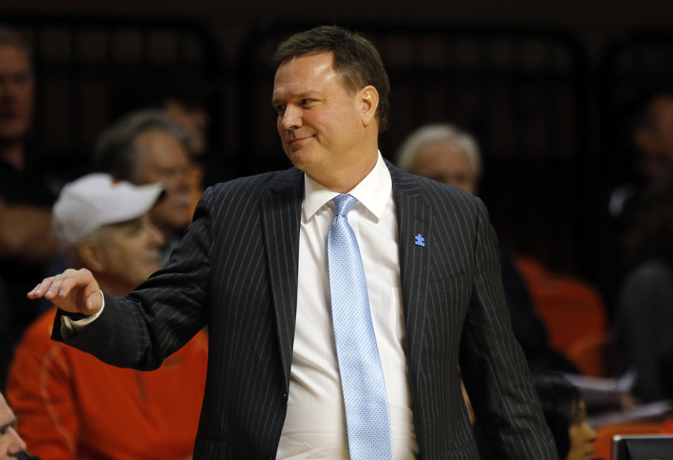 Photo - Kansas head coach Bill Self reacts during the men's college basketball game between Oklahoma State University and the University of Kansas at Gallagher-Iba Arena in Stillwater, Okla.,  Saturday, Feb. 7, 2015. OSU won 67-62. Photo by Sarah Phipps, The Oklahoman