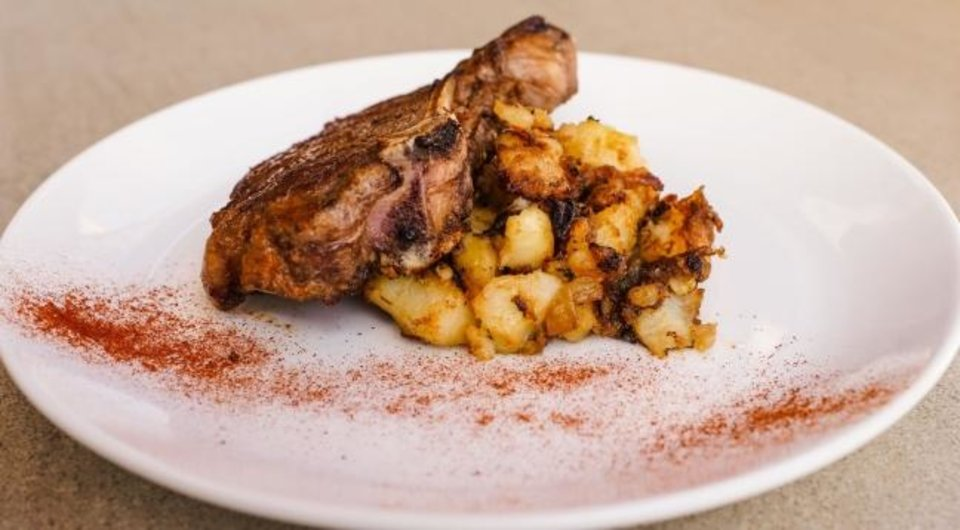 Photo -  Fleischfresser's pork chop dish. [PROVIDED BY OKLAHOMA NATURAL GAS]