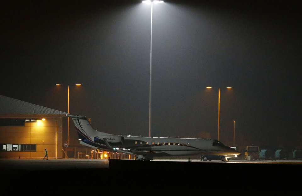 Photo - A plane carrying radical cleric Abu Qatada prepares to take off at RAF Northolt in London for his deportation to Jordan where he faces a retrial for alleged involvement in terrorist plots, Sunday, July 7, 2013. Qatada's deportation was approved after Britain and Jordan signed a treaty agreeing that evidence obtained through torture would not be used against him at his retrial. (AP Photo/Sang Tan)
