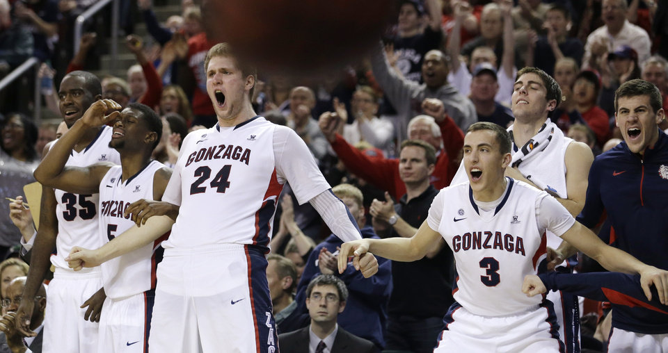 Gonzaga's bench reacts on a dunk by Kelly Olynyk late in the second half of an NCAA college basketball game against Kansas State Saturday, Dec. 15, 2012, in Seattle. Gonzaga won 68-52. (AP Photo/Elaine Thompson) ORG XMIT: WAET114