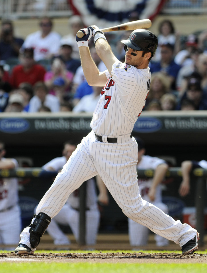 Minnesota Twins\' Joe Mauer hits a single off Detroit Tigers pitcher Anibal Sanchez in the first inning of a baseball game Sunday, Sept. 30, 2012 in Minneapolis. Mauer, in a race for the American League batting title, went 3-for-4 and a walk in the Tigers\' 2-1 win. (AP Photo/Jim Mone)