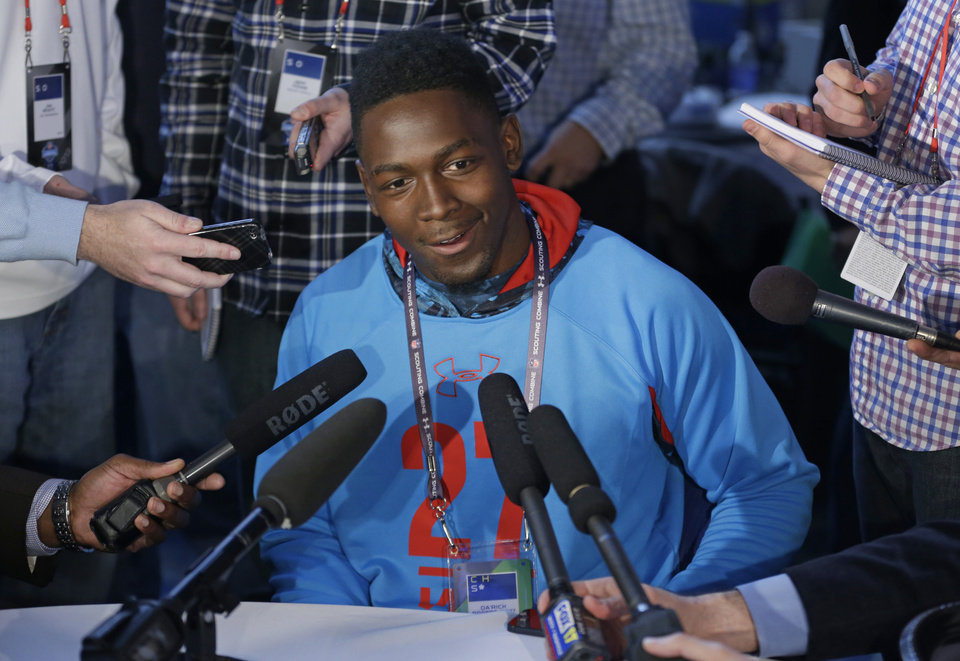 Photo - Tennessee Tech receiver Da'Rick Rogers answers a question during a news conference at the NFL football scouting combine in Indianapolis, Friday, Feb. 22, 2013. (AP Photo/Michael Conroy)
