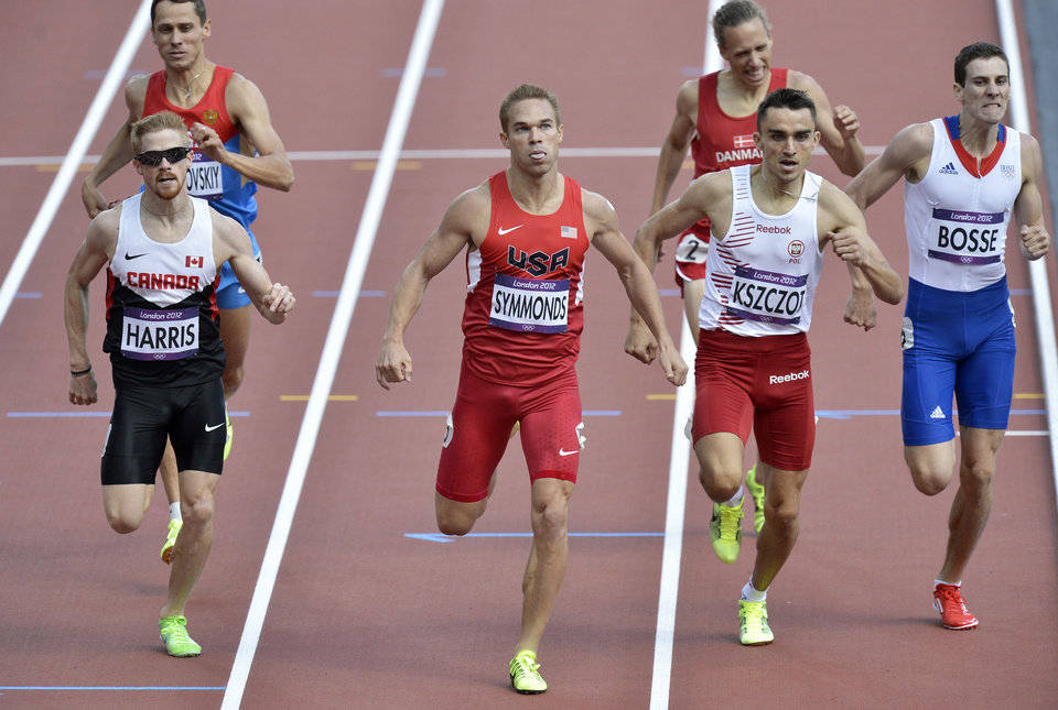 Photo - United States' Nick Symmonds leads the field Monday in a men's 800-meter heat in Olympic Stadium at the 2012 Summer Olympics in London. AP Photos