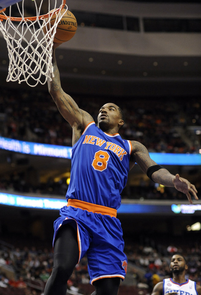 New York Knicks\' J.R. Smith (8) dunks the ball during the first half of an NBA basketball game against the Philadelphia 76ers on Monday, Nov. 5, 2012, in Philadelphia. (AP Photo/Michael Perez)