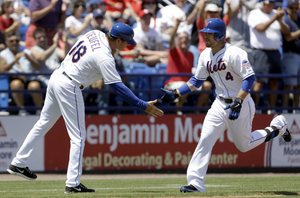 Photo - New York Mets' Collin Cowgill, right, is congratulated by third base coach Tim Teufel while rounding the bases after hitting a two-run home run during the fourth inning of an exhibition spring training baseball game against the St. Louis Cardinals, Friday, March 29, 2013, in Port St. Lucie, Fla. (AP Photo/Jeff Roberson)