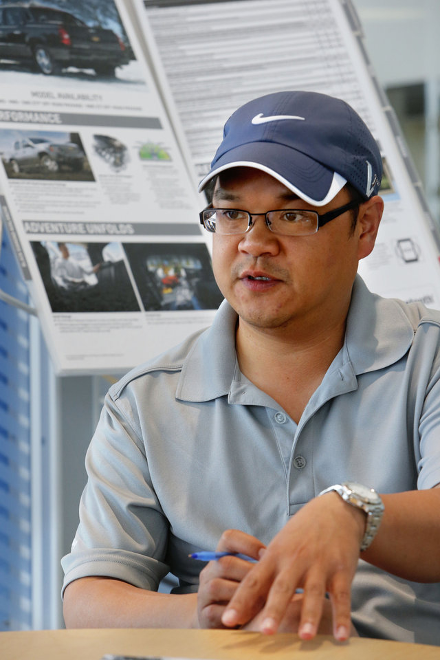 Photo - Sales representative Jeff Nguyen talks about the customers at David Stanley Chevrolet on Interstate 240 and Walker Avenue. Dealerships have started to see customers with insurance checks to spend on a new vehicle following May severe weather.  STEVE SISNEY - THE OKLAHOMAN