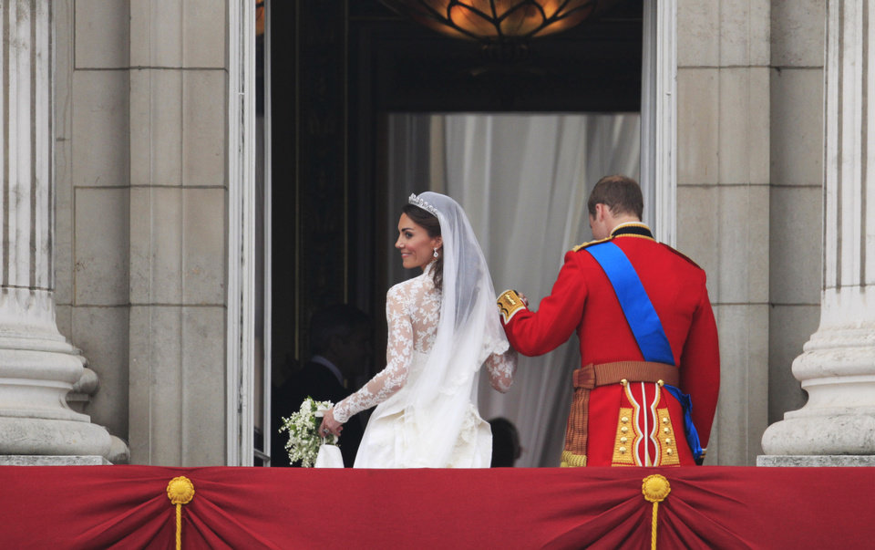 Photo - Britain's Prince William and his wife Kate, Duchess of Cambridge go back inside from the balcony of Buckingham Palace after the Royal Wedding in London Friday, April, 29, 2011. (AP Photo/Matt Dunham) ORG XMIT: RWMG181