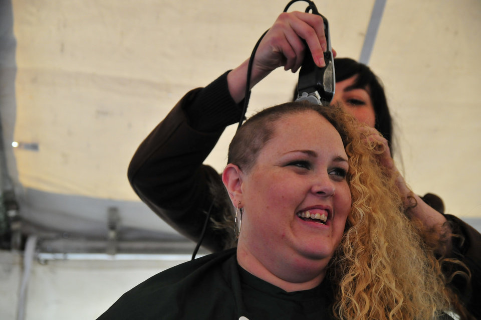 Jordan Keith, a member of the 10 Strong team, gets her head shaved in order to help raise money for the St. Baldrick's charity at VZD's Restaurant and Club in Oklahoma City, Okla. Sunday, March 23, 2013.  Photo by Nick Oxford, for The Oklahoman