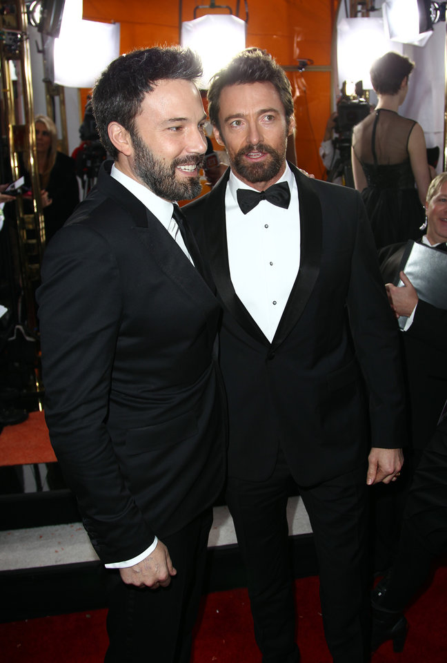 Photo - Director Ben Affleck, left, and actor Hugh Jackman arrive at the 19th Annual Screen Actors Guild Awards at the Shrine Auditorium in Los Angeles on Sunday, Jan. 27, 2013. (Photo by Matt Sayles/Invision/AP)