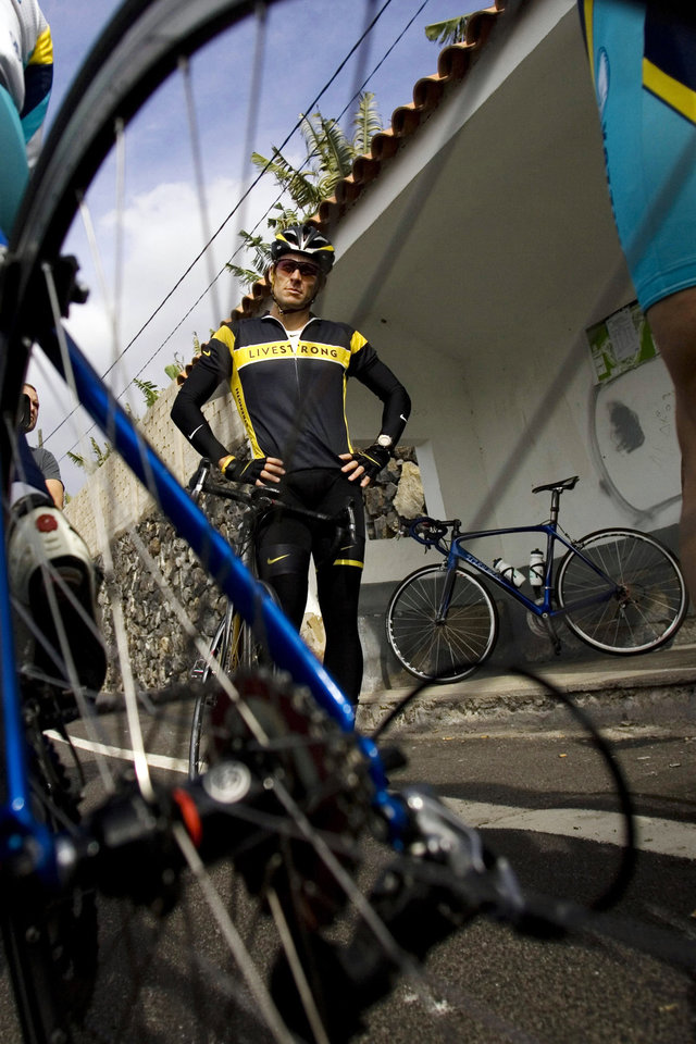 Photo - FILE - In this Dec. 2, 2008, file photo, Lance Armstrong stands in Livestrong apparel before a training session with the Astana cycling team in Los Cristianos, on the Canary Island of Tenerife, Spain. The cyclist was stripped of his Tour de France titles, lost most of his endorsements and was forced to leave the board of his foundation last year after the U.S. Anti-Doping Agency issued a damning, 1,000-page report that accused him of masterminding a long-running doping scheme. (AP Photo/Arturo Rodriguez, File)