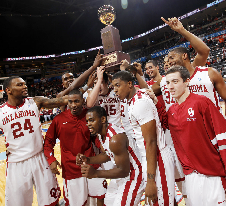 The OU Sooners raise the championship trophy after the Pete Maravich men's college basketball game of the Ramada All-College Classic between the University of Oklahoma Sooners and the University of Houston Cougars at the Chesapeake Energy Arena in Oklahoma City, Saturday, Dec. 17, 2011. OU won, 79-74. Photo by Nate Billings, The Oklahoman