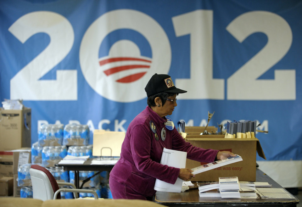 Volunteer Jessie Seles organizes campaign literature at the campaign headquarters for President Barack Obama in Detroit, Monday, Nov. 5, 2012, the day before elections. (AP Photo/The Detroit News, David Guralnick)