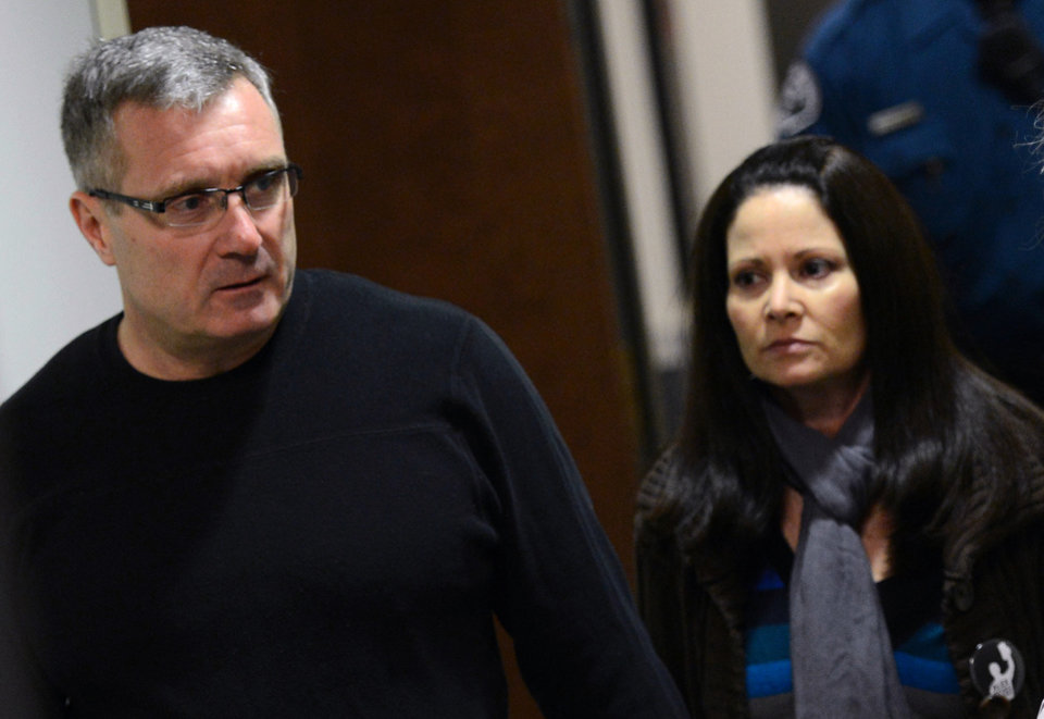Photo - Thomas Teves, left, and his wife Caren Teves arrive for court, Tuesday, Jan. 8, 2012, on the second day of hearings for accused Aurora theater gunman James Holmes, in Centenneial, Colo. The couple's 24-year-old son Alex was killed in the attack. (AP Photo/The Denver Post, RJ Sangosti) MAGS OUT; TV OUT; INTERNET OUT