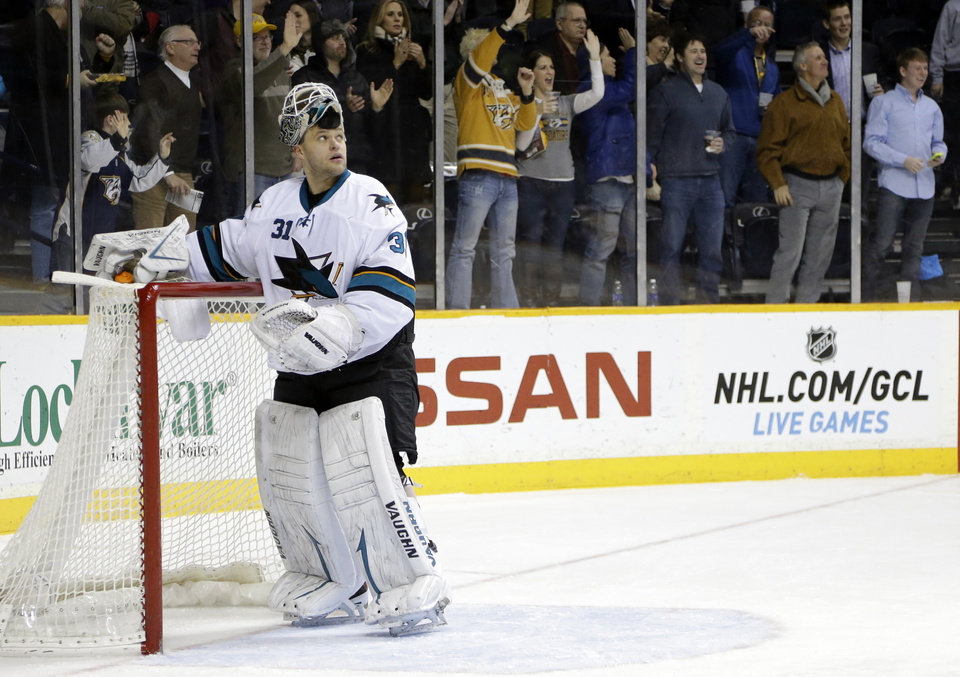 Photo - San Jose Sharks goalie Antti Niemi, of Finland, looks up at the scoreboard after giving up a goal by Nashville Predators' Roman Josi in the second period of an NHL hockey game Tuesday, Jan. 7, 2014, in Nashville, Tenn. (AP Photo/Mark Humphrey)
