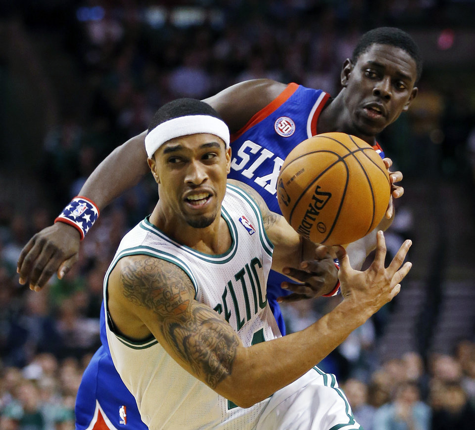 Boston Celtics' Courtney Lee, left loses control of the ball to Philadelphia 76ers' Jrue Holiday in the first quarter of an NBA basketball game in Boston, Friday, Nov. 9, 2012. (AP Photo/Michael Dwyer)