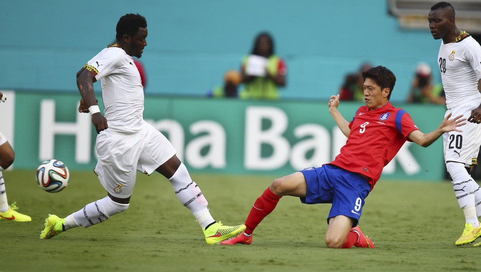 Photo - Ghana's Sulley Muntari (11) and South Korea's Chung Yong Lee (9) battle for the ball during the first half of an international  friendly soccer match in Miami Gardens, Fla., Monday, June 9, 2014. ( AP Photo/J Pat Carter)