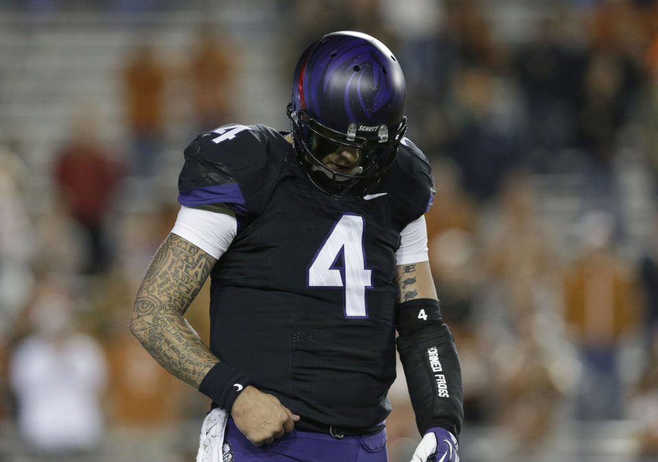 TCU quarterback Casey Pachall (4) hangs his head as he head back to the sideline after throwing a third down incomplete pass during the second half on an NCAA college football game against Texas  Saturday, Oct. 26, 2013, in Fort Worth, Texas. (AP Photo/LM Otero)
