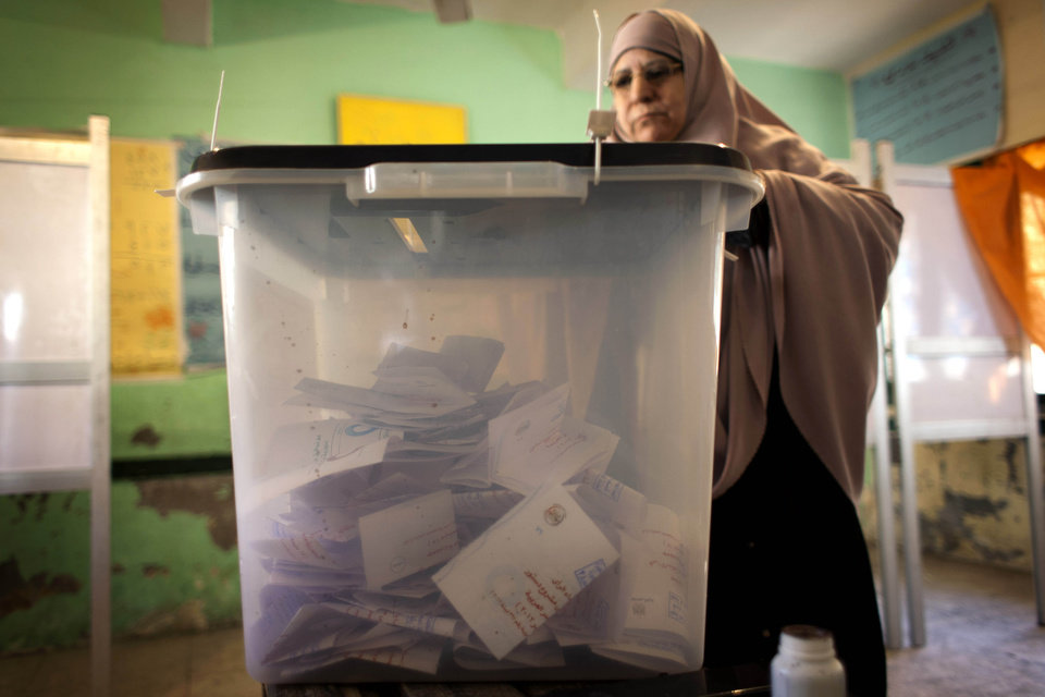 A veiled Egyptian woman casts her vote at a polling station during the second round of a referendum on a disputed constitution drafted by Islamist supporters of President Mohammed Morsi, in Giza, Egypt, Saturday, Dec. 22, 2012. (AP Photo/Nasser Nasser)