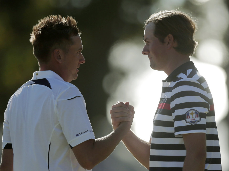 Photo - USA's Webb Simpson, right, congratulates Europe's Ian Poulter after their singles match at the Ryder Cup PGA golf tournament Sunday, Sept. 30, 2012, at the Medinah Country Club in Medinah, Ill. (AP Photo/Charlie Riedel)  ORG XMIT: PGA160