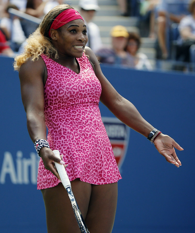 Photo - Serena Williams, of the United States, reacts after a shot against Vania King, of the United States, during the second round of the 2014 U.S. Open tennis tournament, Thursday, Aug. 28, 2014, in New York. (AP Photo/Elise Amendola)
