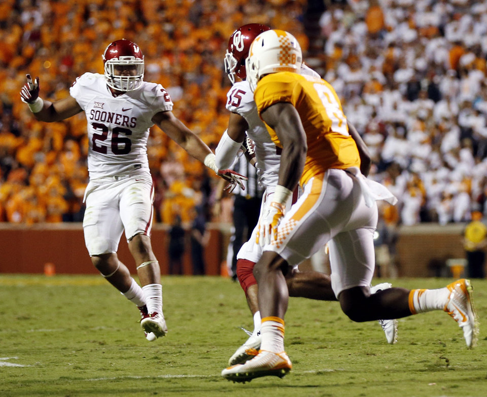 Photo - Oklahoma's Zack Sanchez (15) intercepts as pass intended for Tennessee's Marquez North (8) to end the game in double overtime as Oklahoma's Jordan Evans (26) looks on during a college football game between the Oklahoma Sooners (OU) and the Tennessee Volunteers at Neyland Stadium in Knoxville, Tennessee, Saturday, Sept. 12, 2015. OU won 31-24 in double overtime. Photo by Nate Billings, The Oklahoman