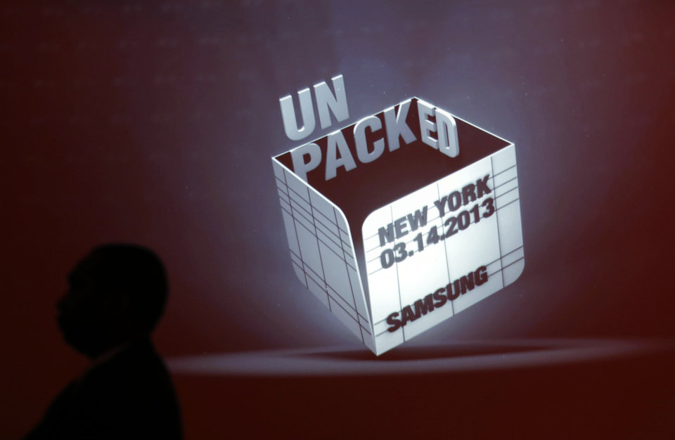 Photo - A security guard stands in front of a projected logo before the Samsung Unpacked event at Radio City Music Hall, Thursday, March 14, 2013 in New York. (AP Photo/Jason DeCrow)