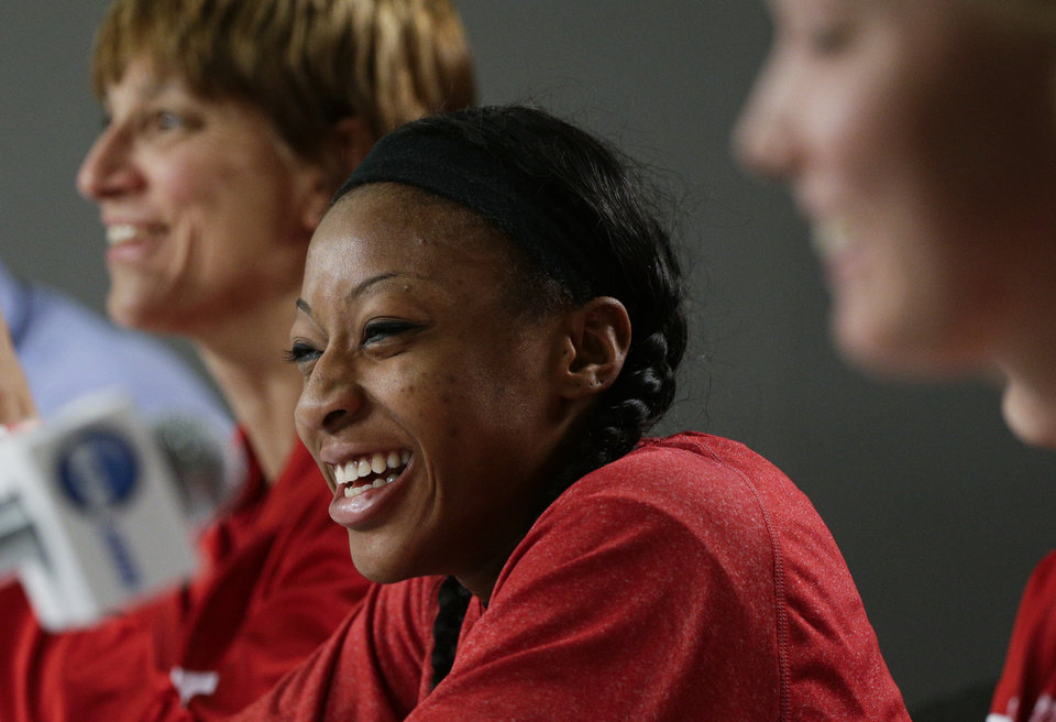 Photo - Nebraska's Tear'a Laudermill, center, smiles as she is joined by head coach Connie Yori, background left, and teammate Emily Cady during a news conference on Sunday, March 23, 2014, in Los Angeles. Nebraska is scheduled to play BYU in a second-round game of the NCAA women's college basketball tournament on Monday. (AP Photo/Jae C. Hong)