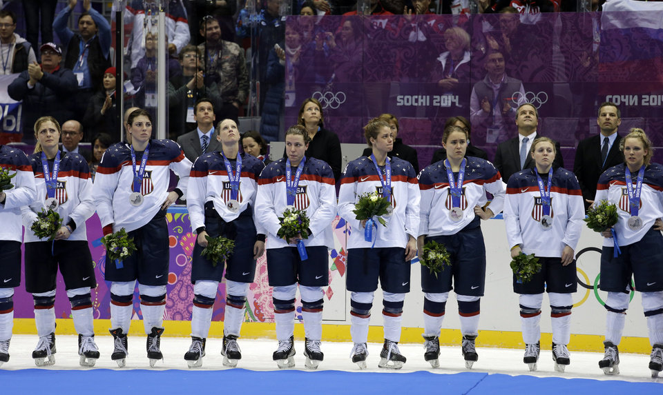 Photo - Team USA reacts after receiving their silver medals after losing to Canada 3-2 in overtime of the gold medal women's ice hockey game at the 2014 Winter Olympics, Wednesday, Feb. 19, 2014, in Sochi, Russia. (AP Photo/David Goldman)