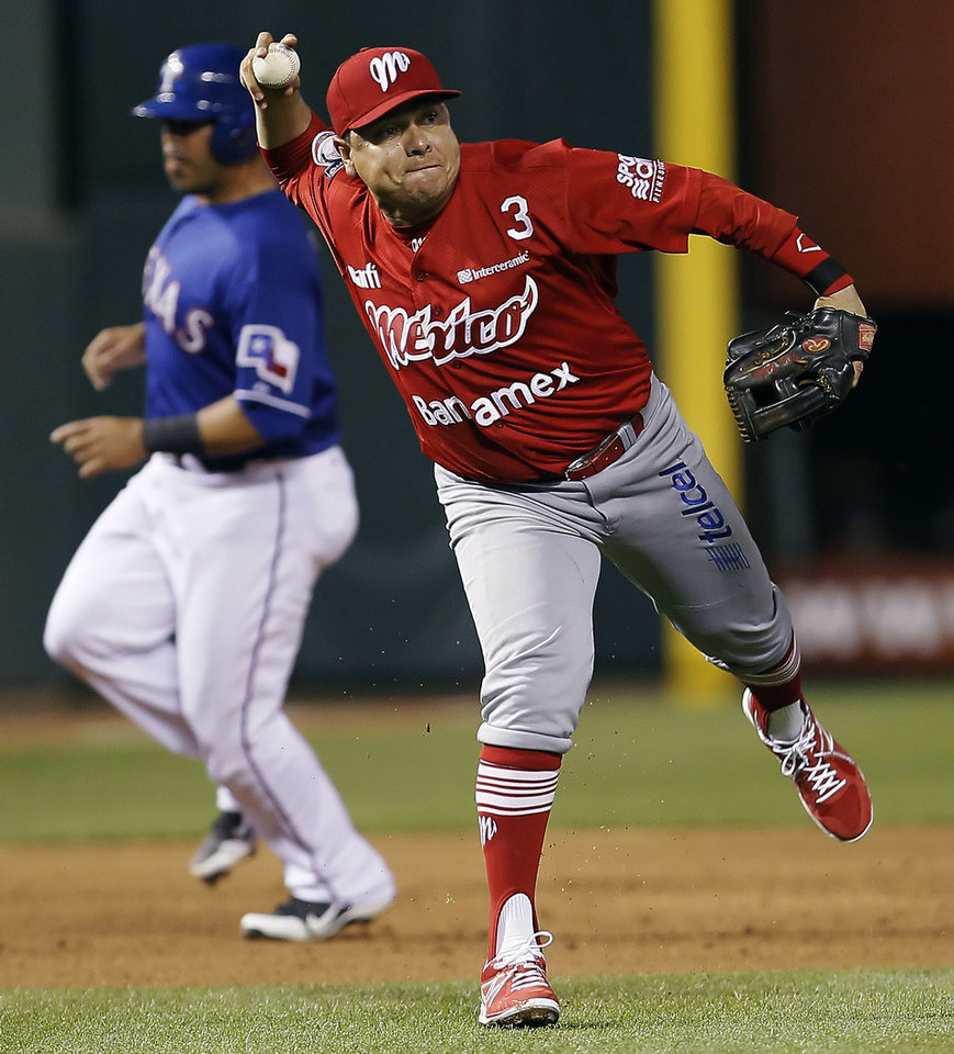 Mexico City Red Devils third baseman Sergio Gastelum (14) throws to first in an attempt to force out Texas Rangers' Craig Gentry during the sixth inning of a spring training exhibition baseball game, Thursday, March 28, 2013, in Arlington, Texas. Gentry was safe on the play. (AP Photo/The Fort Worth Star-Telegram, Brandon Wade)  MAGS OUT; (FORT WORTH WEEKLY, 360 WEST); INTERNET OUT