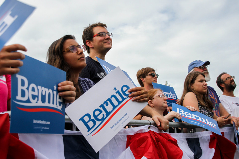 Photo - Supporters look up at Bernie Sanders during a rally at Reaves Park in Norman, Oklahoma Sept. 22, 2019 [Paxson Haws/The Oklahoman]