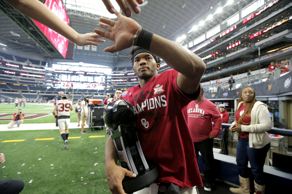 Photo - Oklahoma's Kyler Murray (1) celebrates after the Big 12 Championship football game between the Oklahoma Sooners (OU) and the Texas Longhorns (UT) at AT&T Stadium in Arlington, Texas, Saturday, Dec. 1, 2018.  Oklahoma won 39-27. Photo by Bryan Terry, The Oklahoman